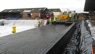 ACO Qmax & StormTanks create a drainage system discharging run-off to local watercourse at controlled rate in Newark