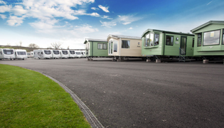 In a Shrewsbury caravan park ACO MultiDrain conveys surface water run-off  to a created landscaped area